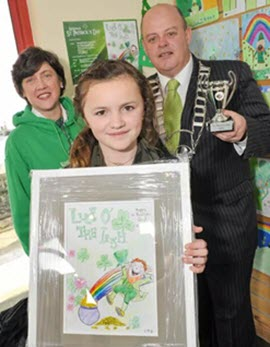 Ellie Mai Dyer from the Gaelscoil Chionn tSaile won the St. Patrick's Day Children's Art Competition that was presented by Tomas O'Brien, Chairman of Kinsale Chamber of Tourism & Business at the Kinsale Tourist Office.